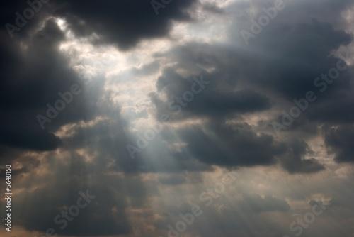 Rays of light shining throug dark clouds