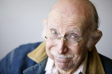 Portrait Of A Senior Citizen Wearing Glasses