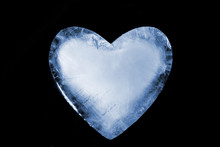 An Ice Cold Blue Heart. Over Black.