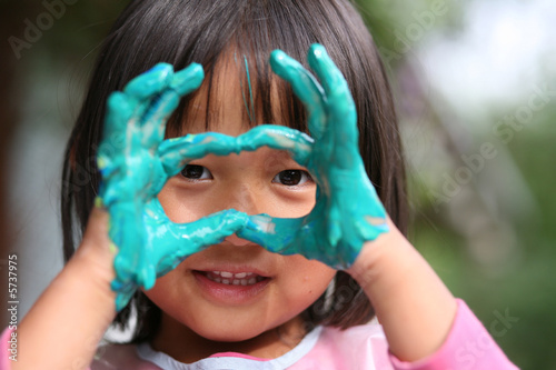 child painting with hands and playing with colours Canvas Print