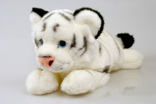 Pretty Tiger Toy Isolated Over Gray Background