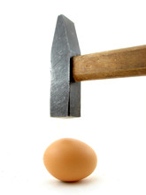 Hammer And Egg Isolated On White Background