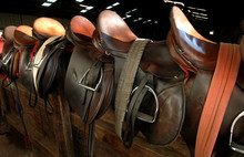 Saddle Lined Up On The Fence