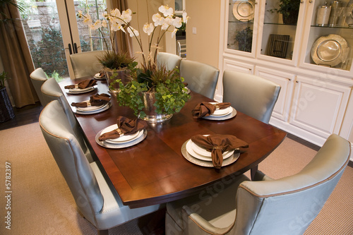 Dining room and table with luxurious decor. Poster