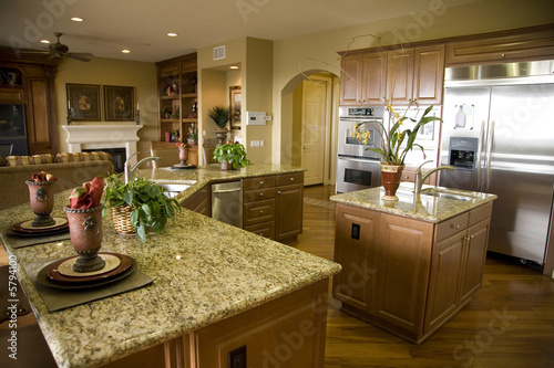 Luxury home kitchen with a granite top island.
