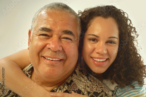 Fotografie, Obraz  Studio portrait of father and daughter laughing and being happy