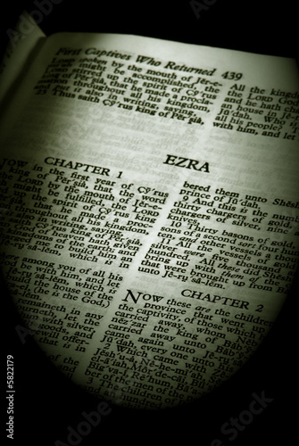 Photo  the book of ezra old testament finished in sepia