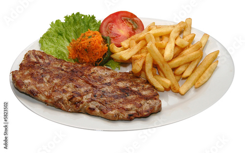 Foto op Canvas Steakhouse Fresh steak with potatoes and lettuce