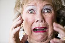 Close-up Of A Horrified Senior...