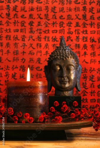 Tuinposter Boeddha Asian candle with red orential background