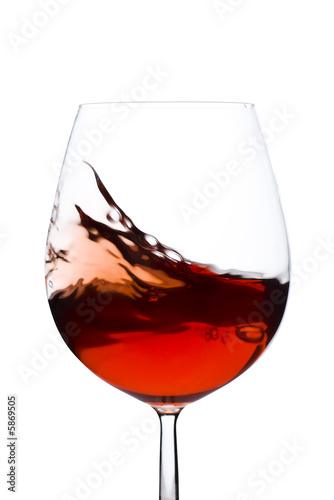 Papiers peints Vin Isolated and moving red wine glass over a white background