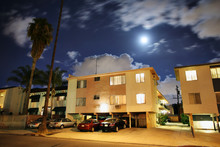 Residential Street With Apartment Buildings At Night In LA
