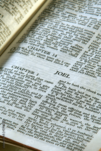 Photo  holy bible open to the book of joel in the old testament
