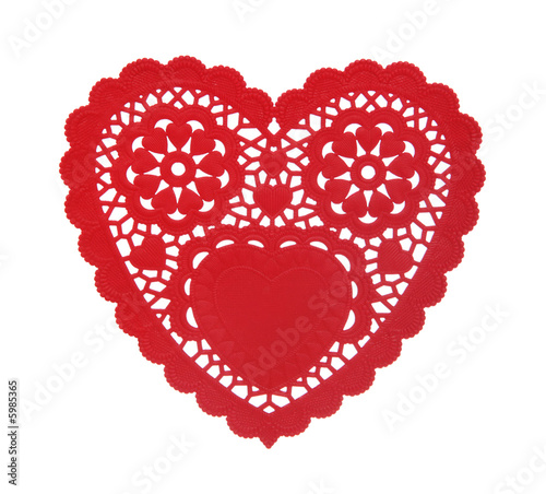 A heart shaped doily isolated over a white background Canvas-taulu