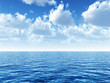 canvas print picture - cloudy blue sky above a blue surface of the sea