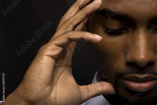 African American businessman is thinking intensely Plakát