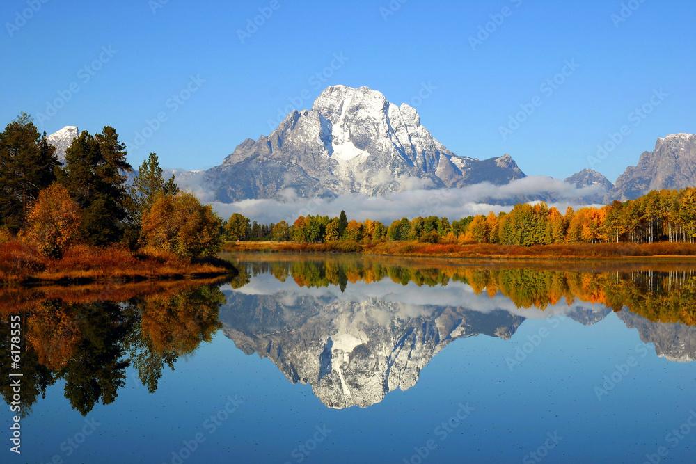 Fototapeta Reflection of mountain range in lake, Grand Teton National Park