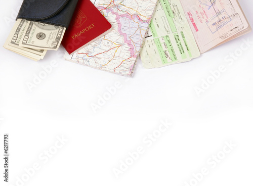 Travel frame on white with passport, map, fly tickets and money ...