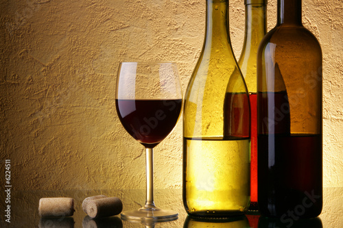 Still-life with three wine bottles and glass