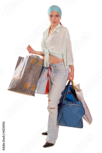 Fototapety, obrazy: Young brunette girl holding bags and gifts after shopping