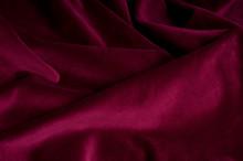 Dark Carmine Fabric Background With Many Folds