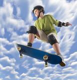 Young skateboarder make a jump on skateboard