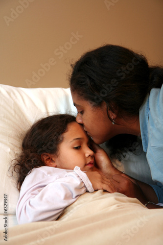 Fotografie, Obraz  Daughter goes to bed and mom tucks her in