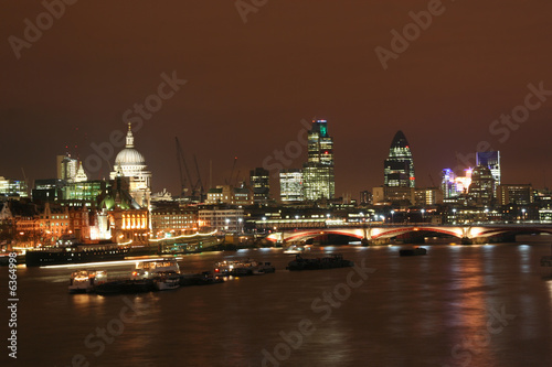 The Thames at night, with St. Pauls cathedral and the City