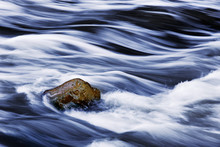 Water Rushing By Rock In River...