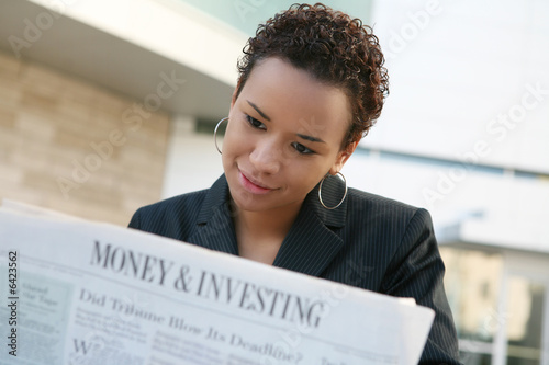 A african american business woman with newspaper - fototapety na wymiar