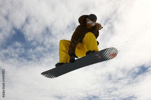 Vászonkép Jumping Snowboarder
