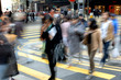 Blurred people crossing street in the city