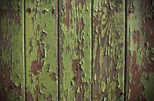 Green Paint Peeling From A Wooden Panel Door