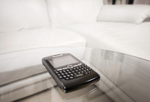 Blackberry PDA On Glass Table