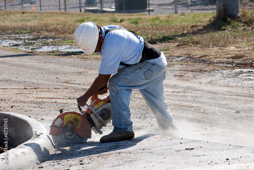 Fotografie, Obraz  Man cutting concrete
