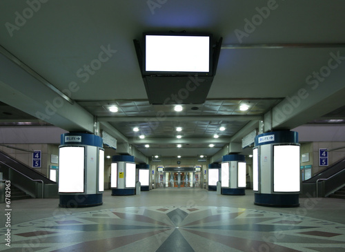 Photo Stands Train Station Underground train station with escalators and billboard colums