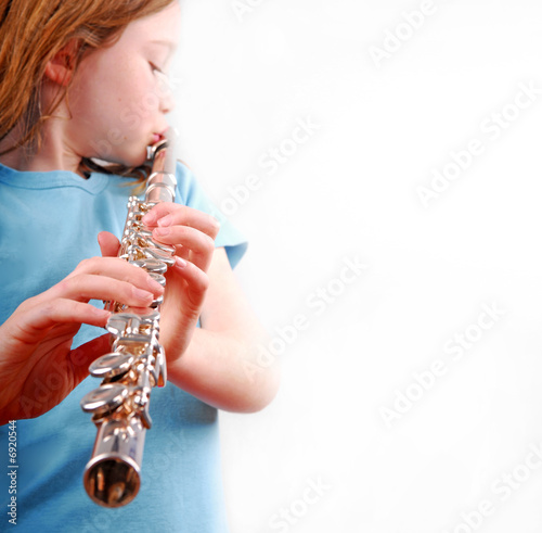 Fotografie, Obraz  Young Girl Playing Flute