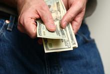 Man Counting US Dollars
