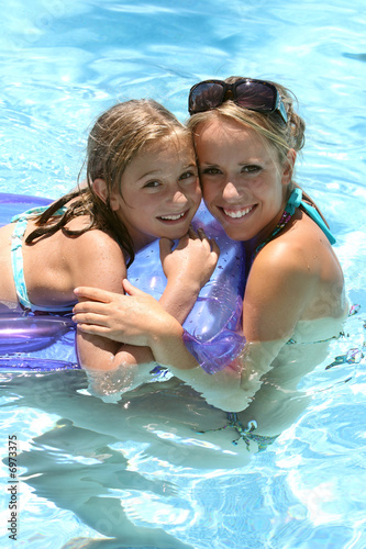Fotografie, Obraz  woman and little girl  in a swimming pool