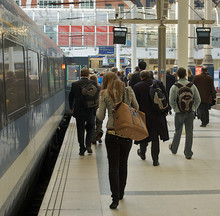People Rush From A Train To Their Jobs