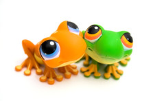 Two Frog Toys Isolated On White Background