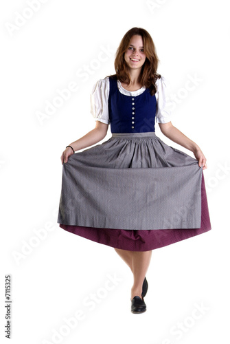 Leinwand Poster woman in Dirndl drops a curtsey