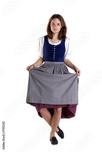 Fototapeta woman in Dirndl drops a curtsey
