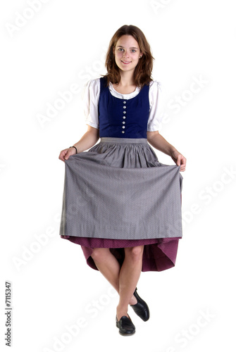 Foto woman in Dirndl drops a curtsey