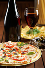 Fototapeta Do pizzerii still life with red wine and pizza