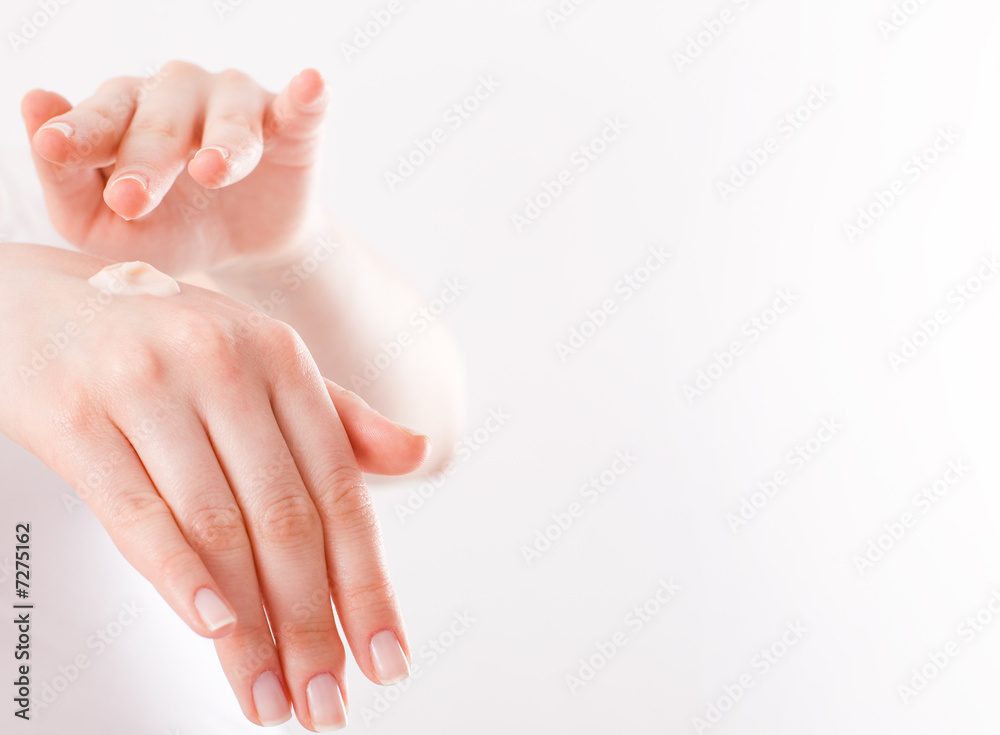 Fototapeta woman applying cream to her hands