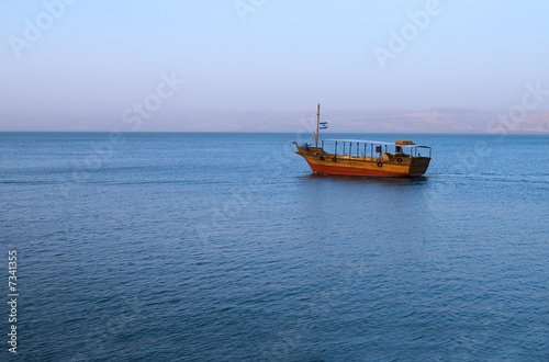 Valokuvatapetti Boat on The sea of Galilee