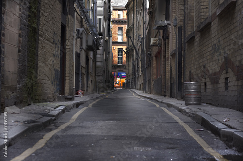 Looking down a long dark back alley Canvas Print