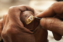 Goldsmith Working On Gold Ring