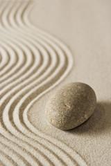 Fototapeta na wymiar Stone on raked sand